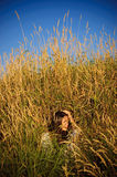 Hippie girl in the grass. The having a rest hippie girl sits in a grass Royalty Free Stock Images