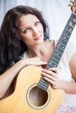 Hippie girl with the guitar on white Royalty Free Stock Photo