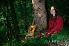 Hippie girl with the guitar Stock Photography