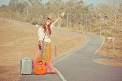 Hippie girl hitchhiking Royalty Free Stock Photo
