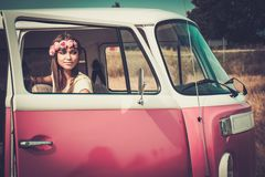 Hippie girl in a minivan Royalty Free Stock Images