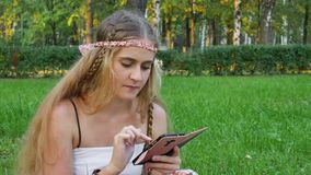 Hippie girl online  internet shopping  cellphone student. Swipe stock video footage