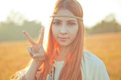 Hippie girl with peace signs Royalty Free Stock Photography
