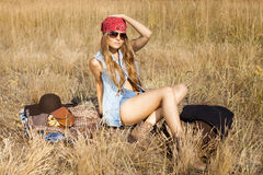 Hippie girl preparing to have picnic on a meadow Royalty Free Stock Photography