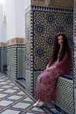 Hippie girl smiling next to beautiful Moroccan tiling stock photos