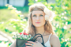 Hippie girl with summer flowers. Outdoors Royalty Free Stock Photography