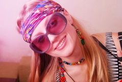 Hippie girl in sunglasses looks into the camera Stock Photos