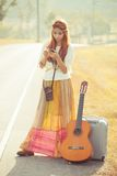 Hippie girl using mobile phone Stock Photography