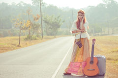 Hippie girl using mobile phone Stock Images