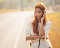 Hippie girl using mobile phone Royalty Free Stock Photos