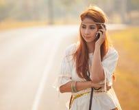 Hippie girl using mobile phone Royalty Free Stock Photos
