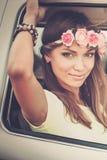 Hippie girl in a van. On a road trip stock photos