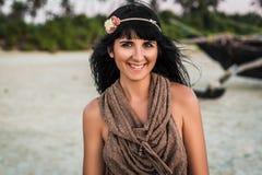 Beautiful young woman at beach looking at camera royalty free stock image