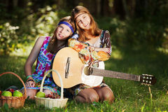 Hippie girls with a guitar outdoor Stock Photos