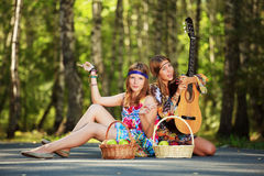 Hippie girls with guitar outdoor Stock Photos