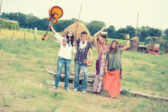 Hippie Group Dancing in the Countryside Stock Photos