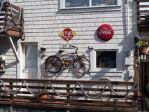 Hippie house with vintage decorations. House with vintage decorations, Coca Cola, stop sign, rusty bicycle, ropes, near San Francisco Royalty Free Stock Photo