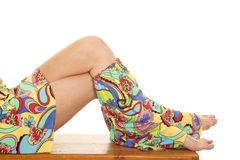 Hippie legs sitting. A woman showing off her hippie clothing Royalty Free Stock Images