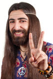 Hippie with long hair making peace sign Stock Photos