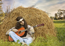 Hippie man playing guitar outdoors Royalty Free Stock Images