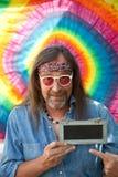 Hippie man pointing towards a blank blackboard stock photos