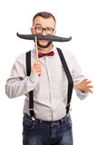 Hippie masculin avec une fausse moustache Photos libres de droits