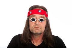 Hippie Old Man. Old funky man with red turban wrapped around his head Stock Image