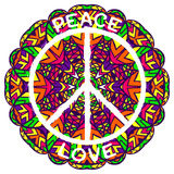 Hippie peace symbol. Peace and love on ornate colorful mandala background. Stock Photo