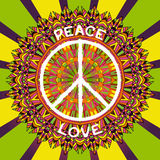Hippie peace symbol. Peace and love sign on ornate colorful mandala background. Royalty Free Stock Photos