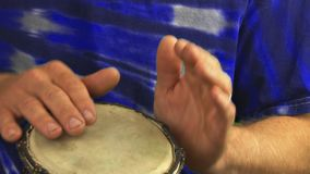 Hippie playing drums stock video footage
