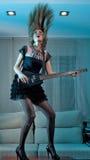 Hippie rocker woman. Playing guitar royalty free stock image