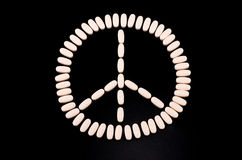 Hippie symbol made of pills. On black background Stock Photography