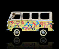 Hippie Van. An old vintage hippie peace and love van over a black background Stock Photos