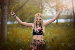 Hippie woman. With crown of flowers blowing flower dandelion royalty free stock image