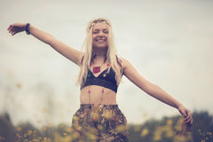 Hippie woman. Woman, dressed in hippie style stands outdoors in the spring park royalty free stock image
