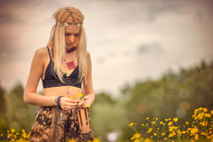 Hippie woman. Woman, dressed in hippie style stands outdoors in the spring park royalty free stock photos