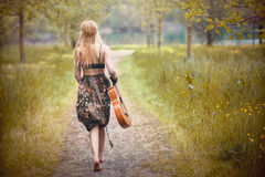 Hippie woman. Woman, dressed in hippie style stands outdoors in the spring park royalty free stock images