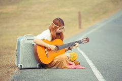 Hippie woman playing music Stock Images
