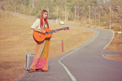 Hippie woman playing music and dancing Royalty Free Stock Image