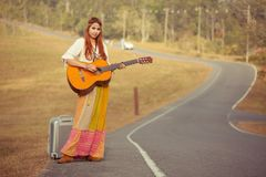 Hippie woman playing music and dancing Stock Photos