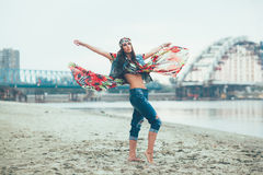 Hippie woman posing barefoot in the sand by the river Stock Photos