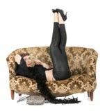 Hippie woman on sofa Stock Photography