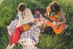 Hippie women resting in the field stock photos