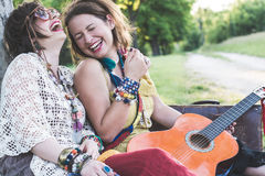 Hippie women resting in the field Royalty Free Stock Photos
