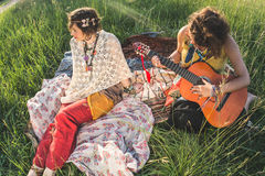 Hippie women resting in the field Royalty Free Stock Photography