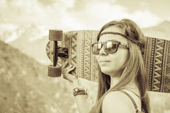 Hippie young and beautiful girl with longboard skateboard at mountain Royalty Free Stock Images