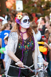 Hippie Zombie Rides Bike In Halloween Parade Royalty Free Stock Photo