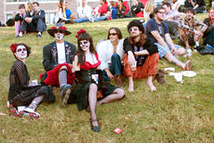 Hippie Zombies Relax And Drink Beer After Halloween Parade Stock Images