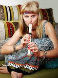 Hippien, welche die Flöte spielen Stockfotografie
