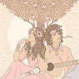 Hippiepaare unter Apfelbaum Stockbild